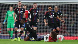 Gary Cahill has claimed that Crystal Palace might have pulled off a shock victory over Arsenal on Sunday if it wasn't for the 'rugby tackle' on Wilfried Zaha...