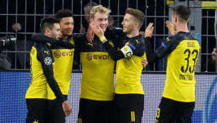 ress Borussia Dortmund sneaked through to the Champions League knockout stages at Inter's expense, defeating Slavia Prague 2-1 atSignal Iduna Park on Tuesday...