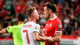 More ​Wales suffered a big blow to their hopes of securing automatic qualification for Euro 2020 as they fell to a late defeat away from home to Hungary. Máté...