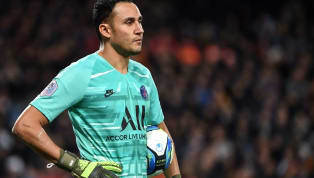 Paris Saint-Germain goalkeeper Keylor Navas was hit on the head by a water bottle thrown at him from the Montpellier section of fans during his team's 3-1...
