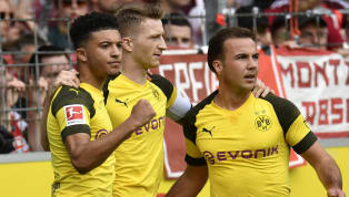 oint ​Borussia Dortmund moved back to within one point of Bayern Munich at the summit of the Bundesliga with a comprehensive 4-0 win away to SC Freiburg.  12...
