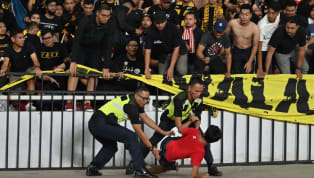 Indonesia have apologised to Malaysia after aggressive confrontations between supporters during a World Cup Asian qualifier left two fans in the Malaysia...