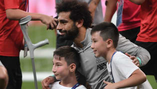 lash Liverpool and Chelsea players enjoyed a heartwarming knockabout with disabled fans during the warm-up for their Super Cup clash in Istanbul on Wednesday...