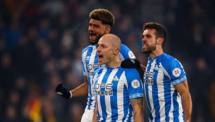 Zone Aaron Mooy scored his first goals since December 2017 to help Huddersfield grind out an all-important 2-0 win away to Wolves that saw them move off the...