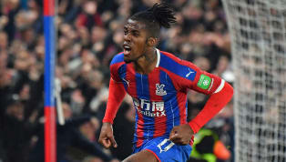 gles Crystal Palace shared the spoils against rivals Brighton as star man Wilfried Zaha's thunderous effort snatched a point at Selhurst Park in the Premier...