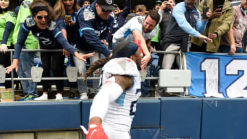 Sept. 19th, 2021; Seattle, Wash: Tennessee Titans running back Derrick Henry (22) high fives fans after they beat the Seahawks in overtime.