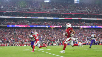 Cardinals WR Rondale Moore (4) scores a touchdown after a catch against the Minnesota Vikings during the second quarter in Glendale, Ariz.