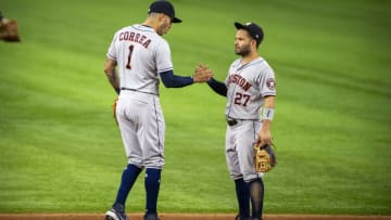 Astros shortstop Carlos Correa (1) and second baseman Jose Altuve (27) celebrate a win against the Rangers on Aug. 28, 2021.
