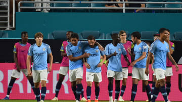 Manchester City teammates celebrate a goal during an International Champions Cup soccer match at Hard Rock Stadium on July 28, 2018.