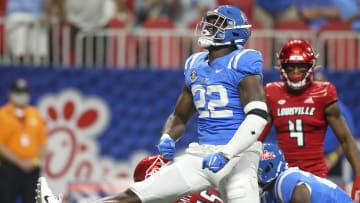 Sep 6, 2021; Atlanta, Georgia, USA; Mississippi Rebels defensive lineman Tariqious Tisdale (22) celebrates after a tackle against Louisville