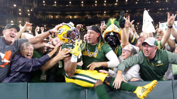 Sep 20, 2021; Green Bay, WI; Green Bay Packers running back Aaron Jones (33) celebrates with a Lambeau Leap after scoring a touchdown against Detroit.