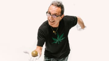 Frenchy holding a giant hashish temple ball.