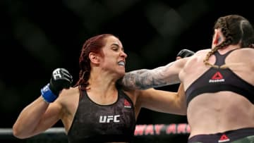 Feb 29, 2020; Norfolk, Virginia, USA; Megan Anderson (red gloves) fights Norma Dumont (blue gloves) | Peter Casey-USA TODAY Sports