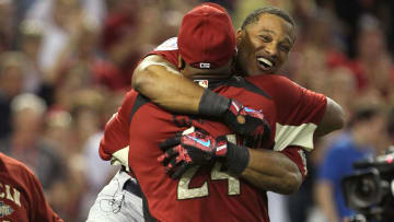 Former New York Yankees shortstop Robinson Cano hugs his father after winning the 2011 Home Run Derby
