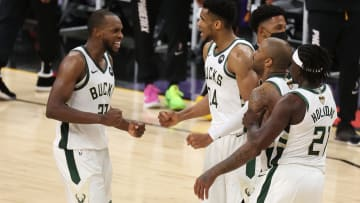 Giannis Antetokounmpo, P.J. Tucker, Jrue Holiday and Khris Middleton celebrate their Game 5 win on the road in Phoenix.