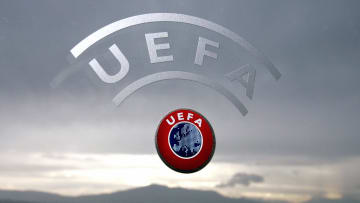 A UEFA logo is seen with Geneva Lake and