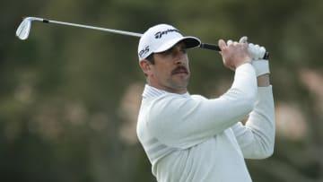 Aaron Rodgers golfing.