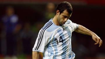 Argentina's Javier Mascherano kicks the