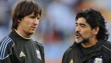 Argentina's coach Diego Maradona (R) spe