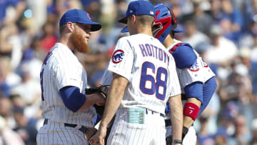 Chicago Cubs pitching coach Tommy Hottovy consoling Craig Kimbrel.