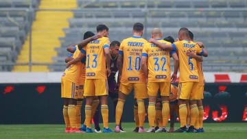 Players of the Tigres UANL price to a game.