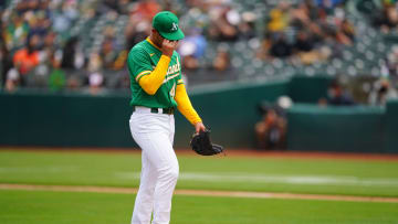 Jesus Luzardo pitching with a broken hand.