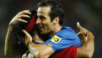 Barcelona's Ludocic Giuly (R) of France