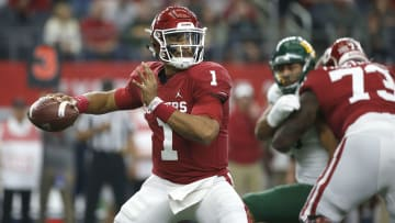 Jalen Hurts attempts a pass against Baylor in the 2019 Big 12 Conference Championship Game.
