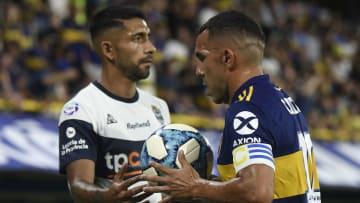 Carlos Tevez e Mathias Garcia