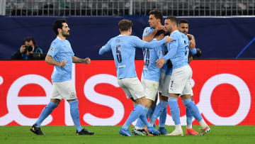 The City team celebrate taking the lead on aggregate