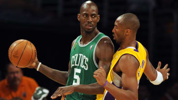 Boston Celtics Kevin Garnett (L) is defe