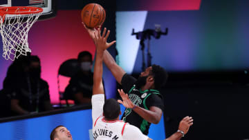Jaylen Brown finishes over Norman Powell