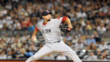 NEW YORK, NY - AUGUST 19: Josh Beckett #19 of the Boston Red Sox pitches against the New York Yankees at Yankee Stadium on August 19, 2012 in the Bronx borough of New York City. (Photo by Jason Szenes/Getty Images)
