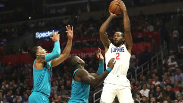 LOS ANGELES, CALIFORNIA - OCTOBER 28:  Kawhi Leonard #2 of the Los Angeles Clippers shoots over Terry Rozier #3 and Miles Bridges #0 of the Charlotte Hornets during the first half of a game at Staples Center on October 28, 2019 in Los Angeles, California.  NOTE TO USER: User expressly acknowledges and agrees that, by downloading and or using this photograph, User is consenting to the terms and conditions of the Getty Images License Agreement. (Photo by Sean M. Haffey/Getty Images)
