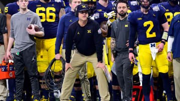 ATLANTA, GEORGIA - DECEMBER 29:  Head coach Jim Harbaugh of the Michigan Wolverines looks on in the first quarter against the Florida Gators during the Chick-fil-A Peach Bowl at Mercedes-Benz Stadium on December 29, 2018 in Atlanta, Georgia. (Photo by Scott Cunningham/Getty Images)