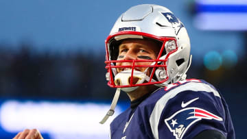 FOXBOROUGH, MA - NOVEMBER 24: Tom Brady #12 of the New England Patriots reacts before a game against the Dallas Cowboys at Gillette Stadium on November 24, 2019 in Foxborough, Massachusetts. (Photo by Adam Glanzman/Getty Images)