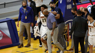 Jamal Murray was helped off the court late in the Nuggest - Warriors game.