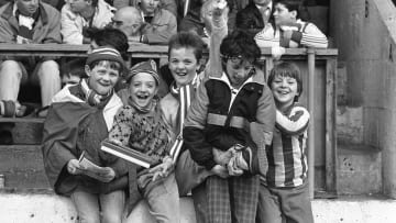 Derry City fans cheering on their team at the Brandywell