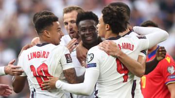 Bukayo Saka celebrates his late headed goal for England