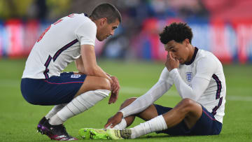 Trent Alexander-Arnold is consoled by Conor Coady