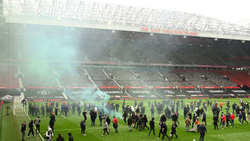 Several fans stormed the pitch at Old Trafford