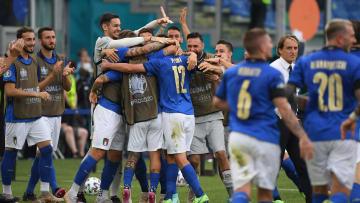 The Italy players celebrate Pessina's goal