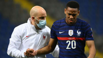 Martial hobbled off with help from France's physio