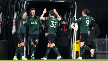 The Spurs team celebrate their first-half goal