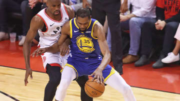 TORONTO,ONTARIO - JUNE 10:  Kevin Durant #35 of the Golden State Warriors injures himself during action against Serge Ibaka #9 of the Toronto Raptors in Game Five of the 2019 NBA Finals at Scotiabank Arena on June 10, 2019 in Toronto, Canada. NOTE TO USER: User expressly acknowledges and agrees that, by downloading and or using this photograph, User is consenting to the terms and conditions of the Getty Images License Agreement. (Photo by Claus Andersen/Getty Images)