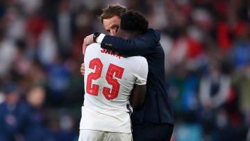 Manager Gareth Southgate comforts Bukayo Saka after his penalty miss against Italy