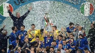 Leonardo Bonucci of Italy holds the trophy while the italian...