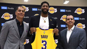 EL SEGUNDO, CA - JULY 13: Anthony Davis (C) is introduced as the newest player of the Los Angeles Lakers during a press conference with general manager Rob Pelinka (L) and head coach Frank Vogel (R) at UCLA Health Training Center on July 13, 2019 in El Segundo, California. NOTE TO USER: User expressly acknowledges and agrees that, by downloading and/or using this Photograph, user is consenting to the terms and conditions of the Getty Images License Agreement. (Photo by Kevork Djansezian/Getty Images)