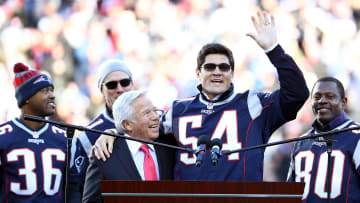 Tedy Bruschi and Robert Kraft.