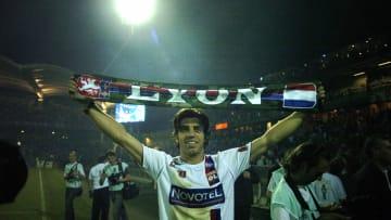 Lyon's team captain Juninho celebrates h...
